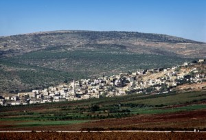 Daberath, a city in the tribal territories of Issachar and Naphtali near Mount Tabor (background); probably the site of the defeat of the Canaanite king Jabin's army under Sisera (Judges 4). Barak gathered an army here to fight Sisera, and it is one traditional site of the Transfiguration.